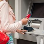 woman using no-fee checking account at atm