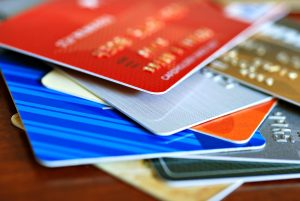 a close-up view of a colorful stack of credit cards